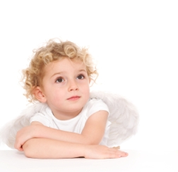 image of small child dressed as an angel