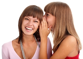 image of two women sharing a secret
